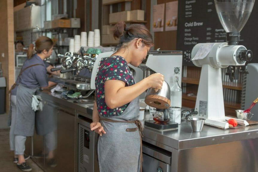Barista preparing coffee at Roots in Bangkok.