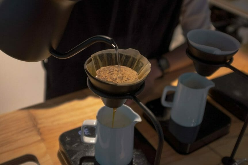 Barista pouring a V60 pour over at Glitch coffee in Tokyo.